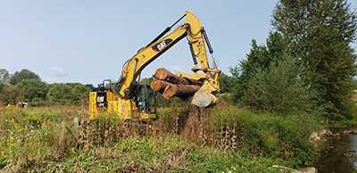 the excavator to help restore Spring Creek